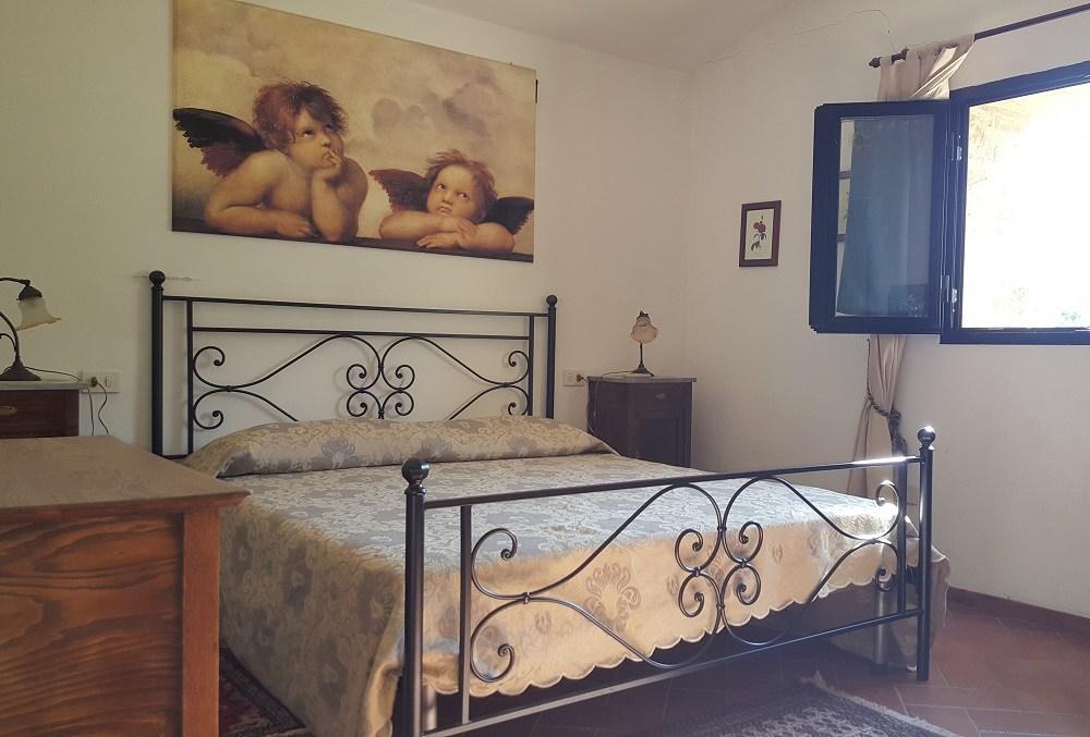 camera matrimoniale-Appartamento Raffaello - La Dragona